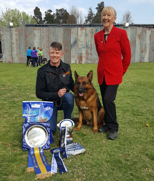2017 Best in Obedience Trial Winner Stuart and Megan MacDonald with their show dog, Quentin.