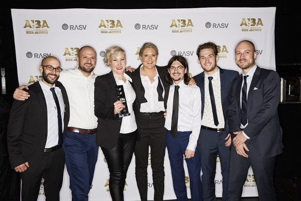 Jayne Lewis and Danielle Allen with the Two Birds brewing team receiving the Champion Medium Australian Brewery trophy at the 2016 AIBA
